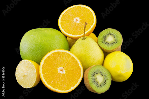 Heap of fruits isolated on black background