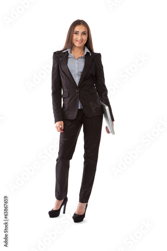 Business woman with laptop standing in full length isolated on w