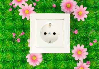 Power outlet on the green grass