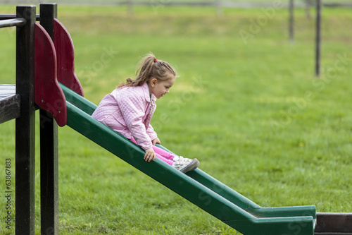 Cute little girl playing in the park