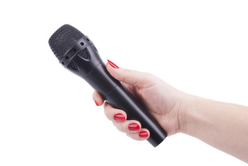 Female hand with a microphone.