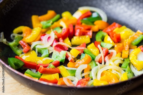 Mixed colorful peppers paprica fried in pan