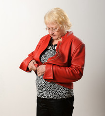 Woman zipping red jacket.