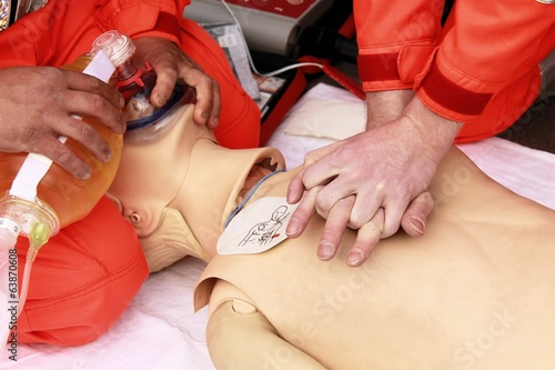 hands of health care professionals who practice resuscitation