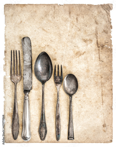Antique cutlery and old cook book page