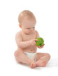 Happy child baby toddler sitting in diaper with green apple