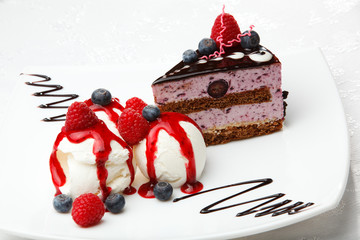 Vanilla ice cream with berries and cake