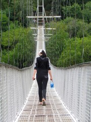 woman crossing the bridge