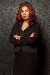 Young hispanic business woman in black outfit
