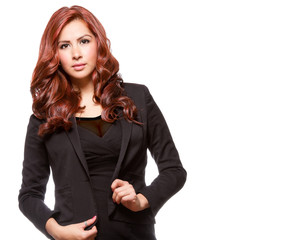 Attractive redheaded business woman in black outfit