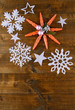 Beautiful snowflakes on wooden background