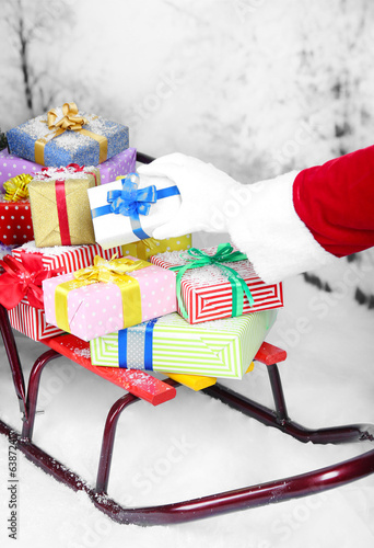 canvas print picture Sledge with Christmas presents, on winter background