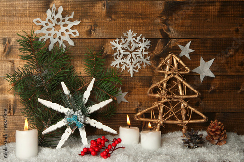 Christmas composition with snowflakes on wooden background