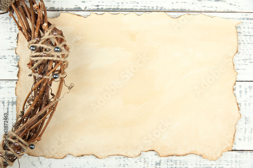 Old paper sheet and beautiful rustic wreath,