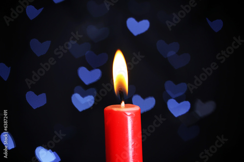 Burning candle on beautiful bokeh background