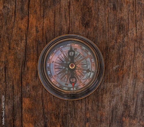 old compass on wood