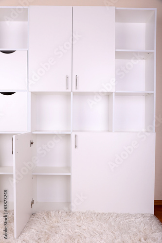 Empty white shelves close up