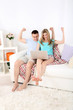 Loving couple sitting with laptop