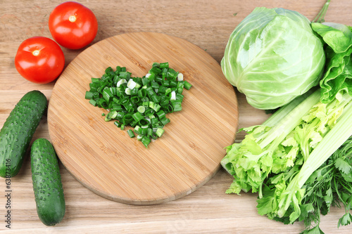 Heart shape of chopped herbs  and fresh vegetables,