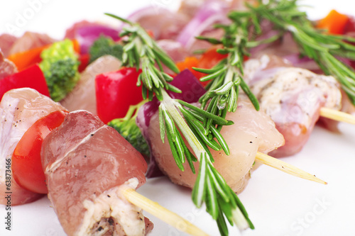 Raw pork kebab with rosemary close up