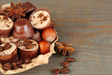 Tasty chocolate candies with coffee beans and nuts