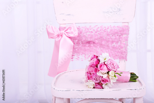 Beautiful wedding bouquet on chair