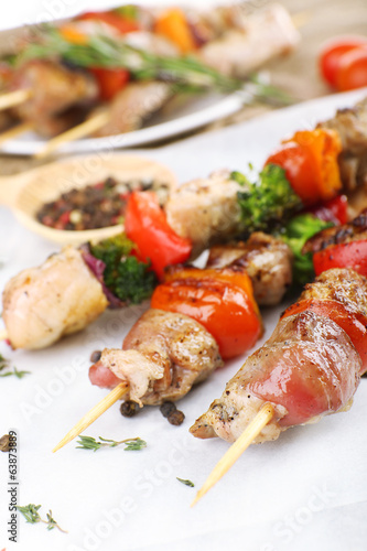 Pork kebab on wooden table close up