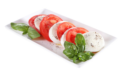 Caprese salad with mozarella cheese, tomatoes and basil