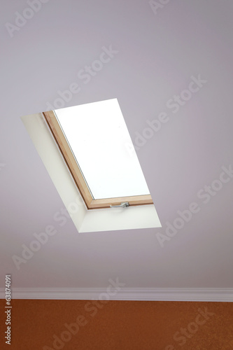 Roof skylight in new modern attic room