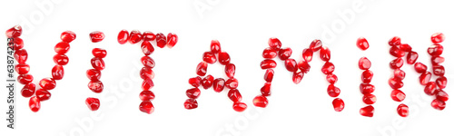 Vitamins sign made of pomegranate seeds, isolated on white