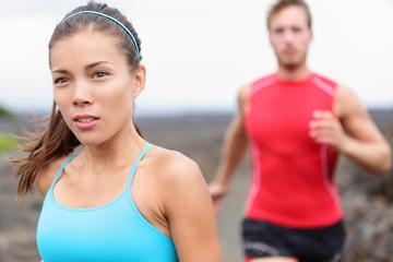 Woman runner closeup - running couple
