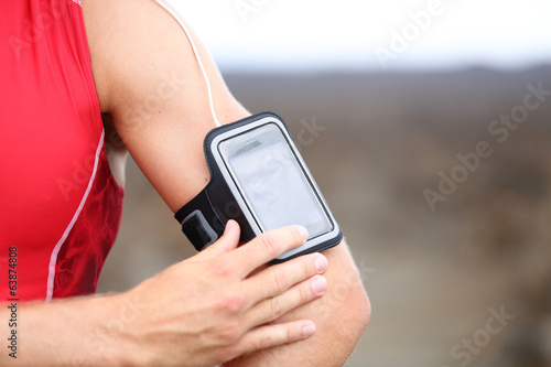 Smart phone running music closeup - male runner