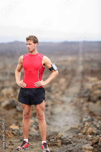 Runner man - portrait of running athlete resting