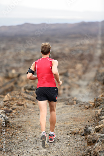 Trail runner man running cross-country run