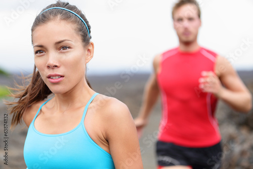 Woman runner closeup - running couple