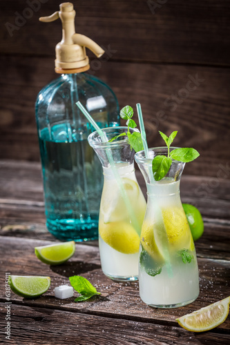 Closeup of lemon drink with mint leaf and citrus fruits