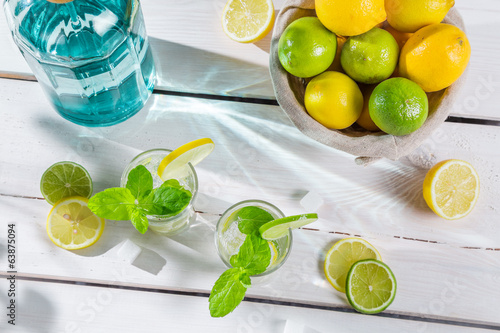 Closeup of citrus drink in summer garden