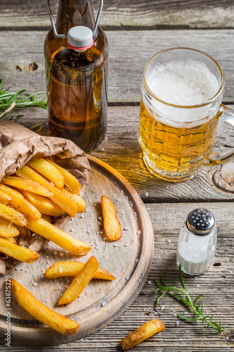 Fresh french fries served with beer