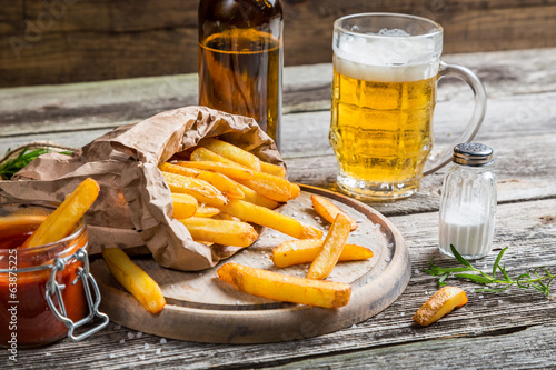 Homemade fresh fries with cold beer