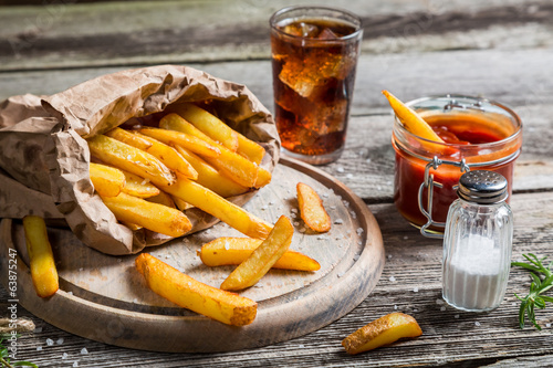 Closeup of homemade fries with cold drink