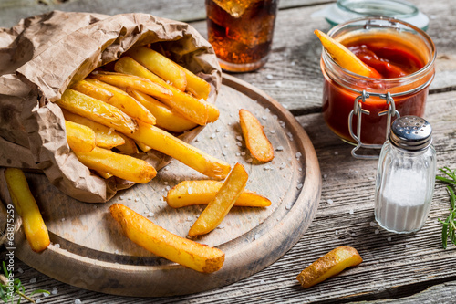 Closeup of homemade fresh fries with cold drink