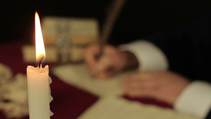 Chronicler writes in the candlelight