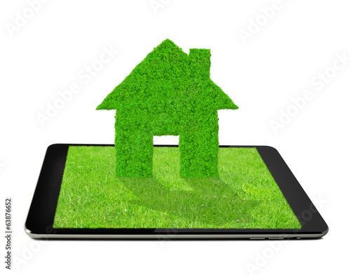 tablet with green house isolated on white