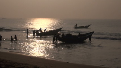 fishermens silhouette and boats in Bengal sea, Tamilnadu,India