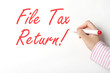 File tax return on whiteboard