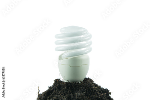 Pile of soil with light bulb green energy concept isolated
