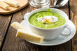 Green cream soup with poached egg