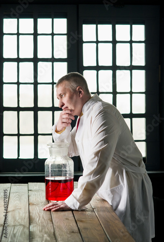 Physician with beaker