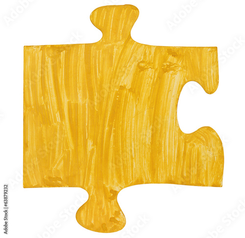 one painted yellow piece of jigsaw puzzle