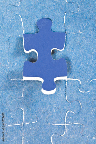setting the last blue piece of puzzle